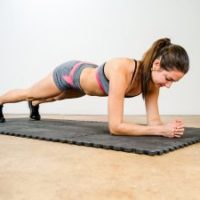 bigstock-Young-Woman-Doing-Elbow-Plank-109643168-300x225